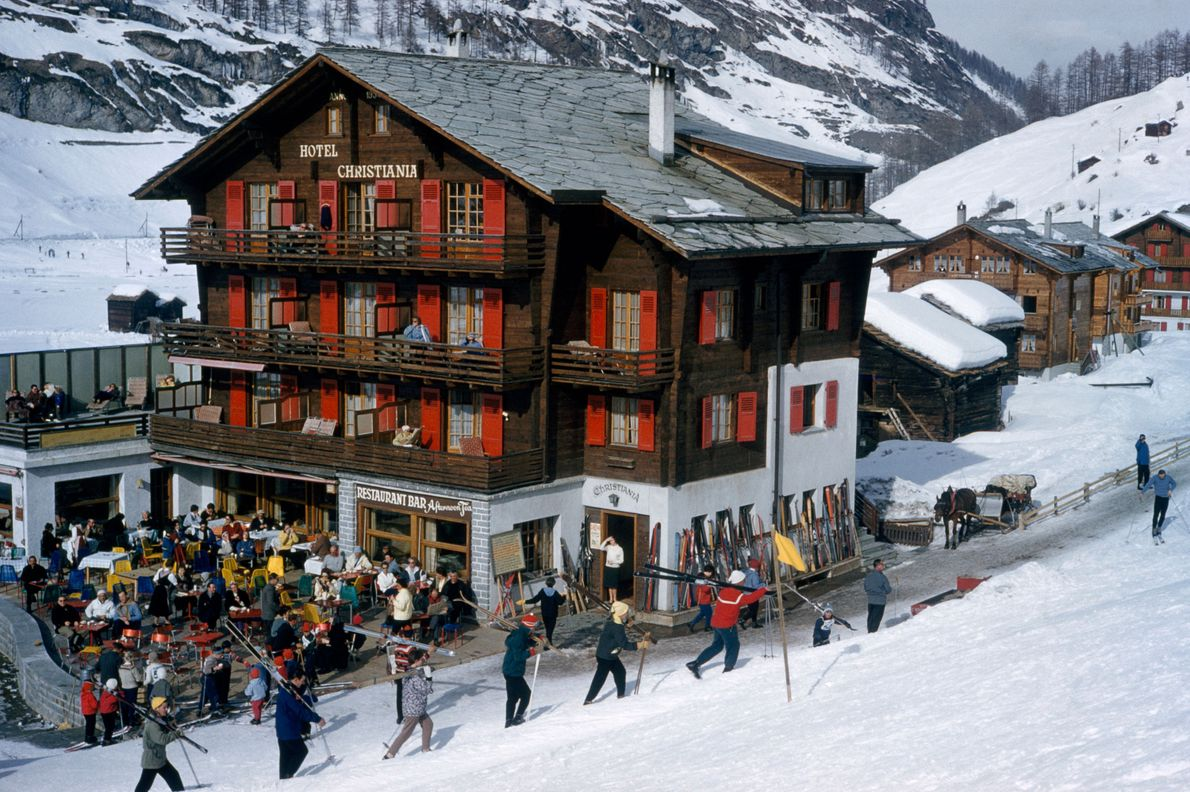 Skiers set off for the slopes on a wintry day.
