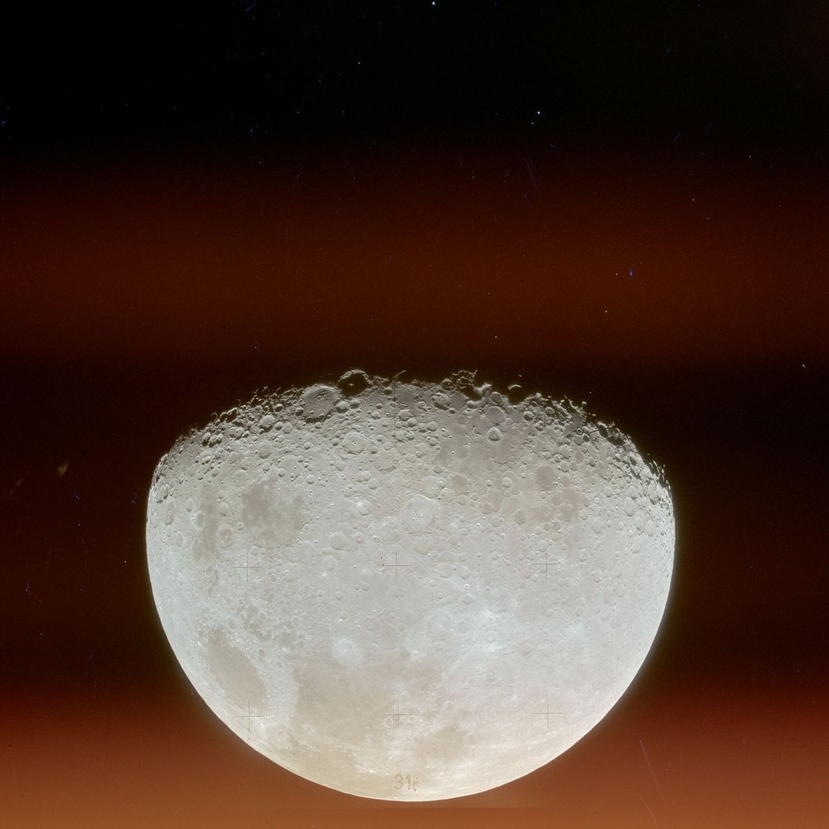 A view of the Moon after leaving lunar orbit.