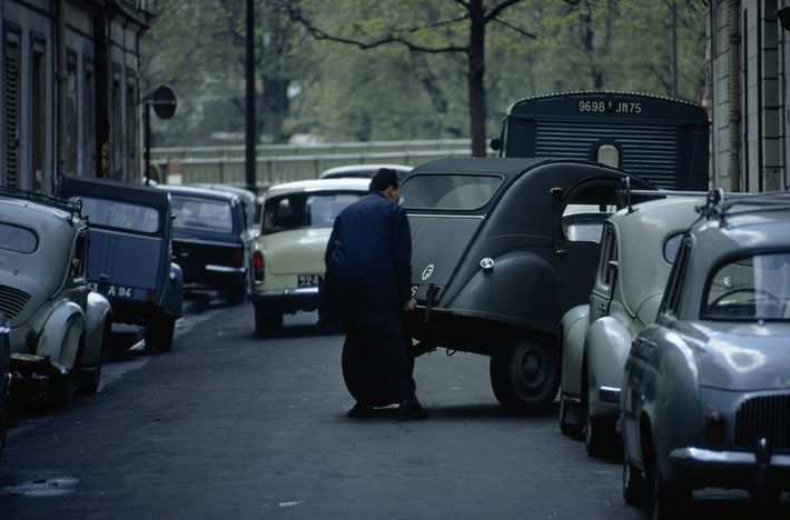 Parking problem solved! Crowded streets rarely deter an ingenious French driver. This one simply stops his ...