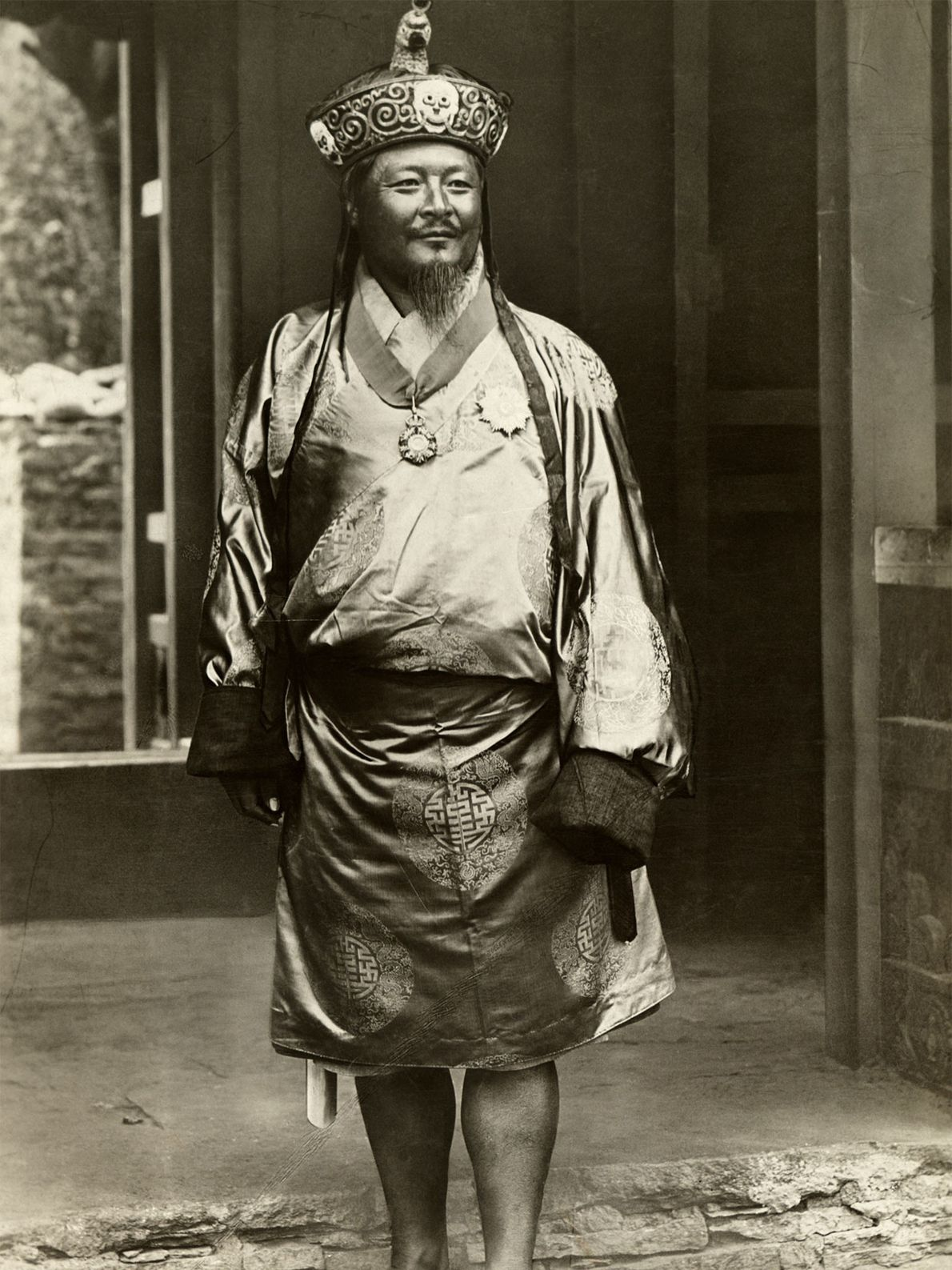 Uygen Wangchuk, the first king of Bhutan, poses for a photograph in royal clothes and a ...