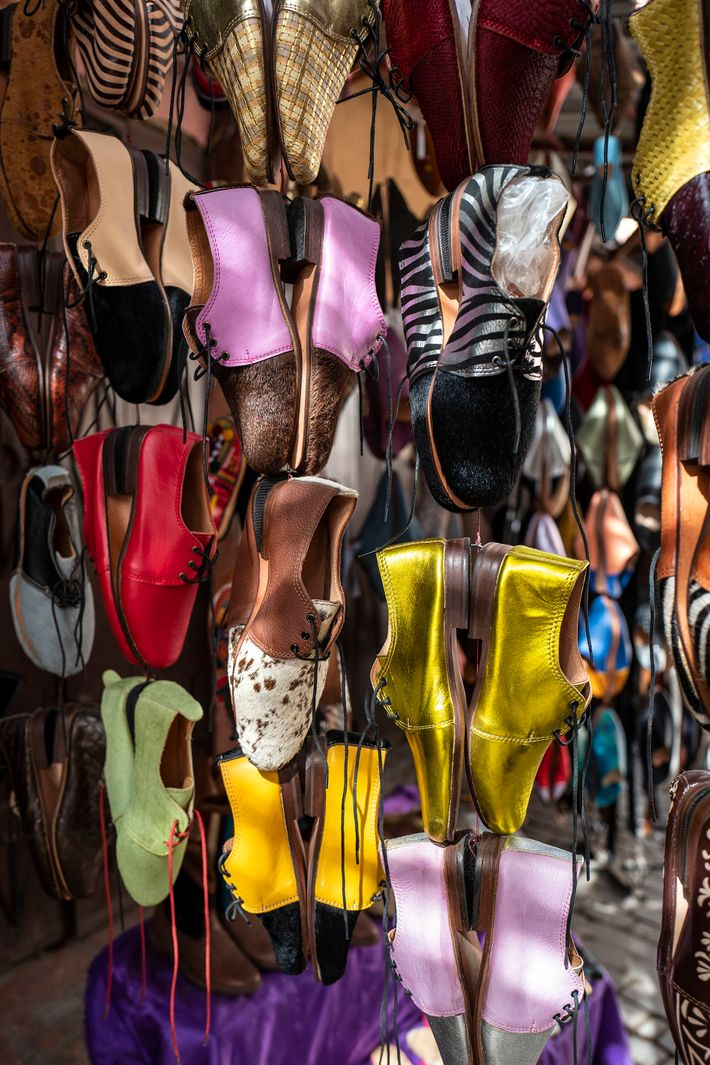 Handmade leather shoes on display in one of the stalls in the souk. Footwear is crafted ...