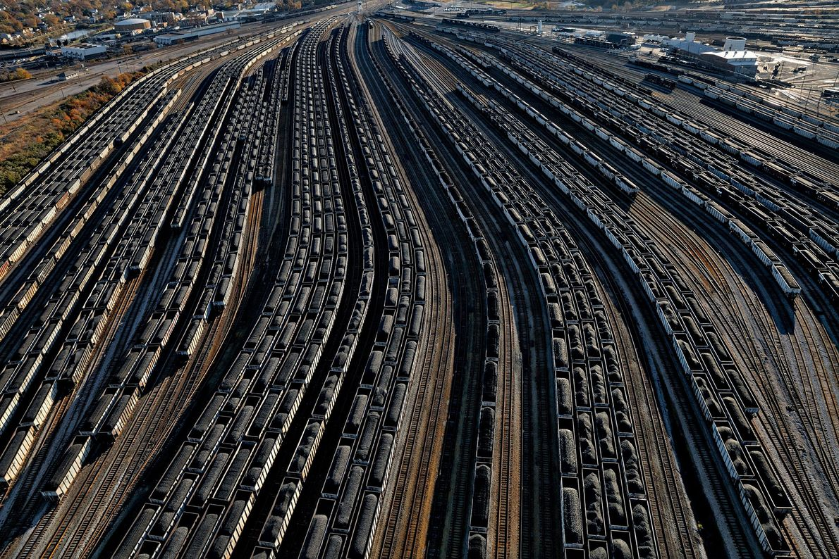 At a coal terminal, railcars loaded with coal line up to fill waiting ships in Virginia.