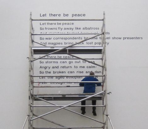 'Let There Be Peace' is inscribed on a wall at Manchester University.