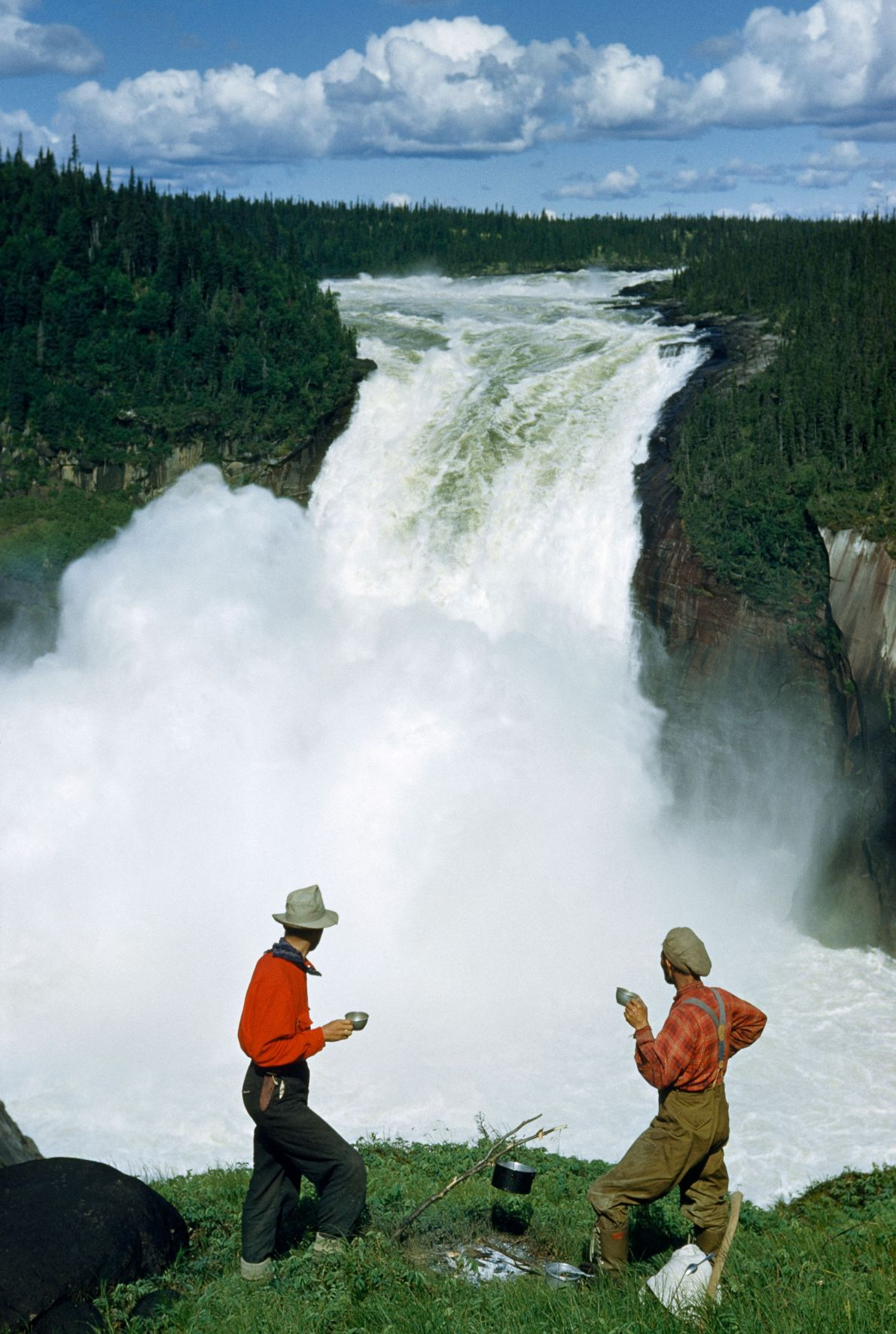 Hikers pause for coffee with a view of plunging Grand Falls.