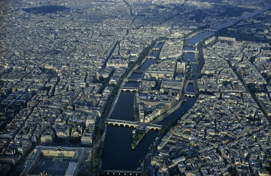 Like a great ship, the Île de la Cité rides the Seine with the Île St. ...