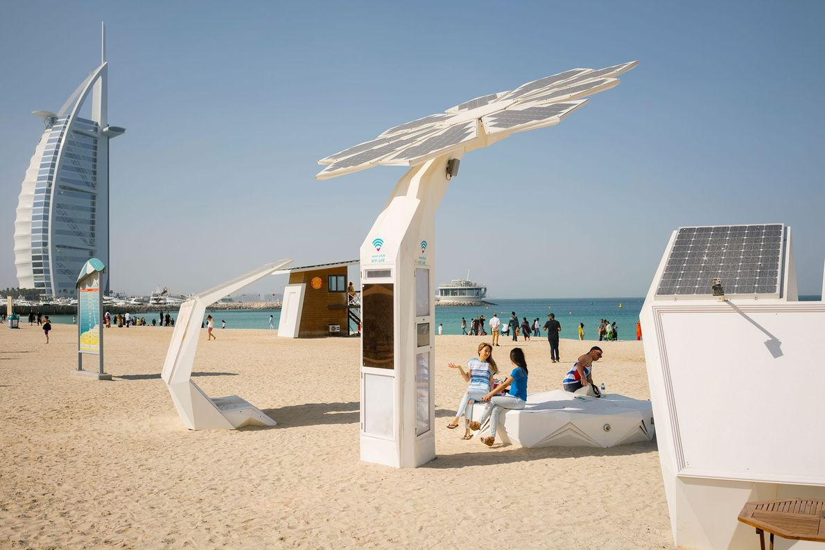 At Jumeirah Beach in the United Arab Emirates, a solar-powered, 21-foot Smart Palm provides a Wi-Fi ...