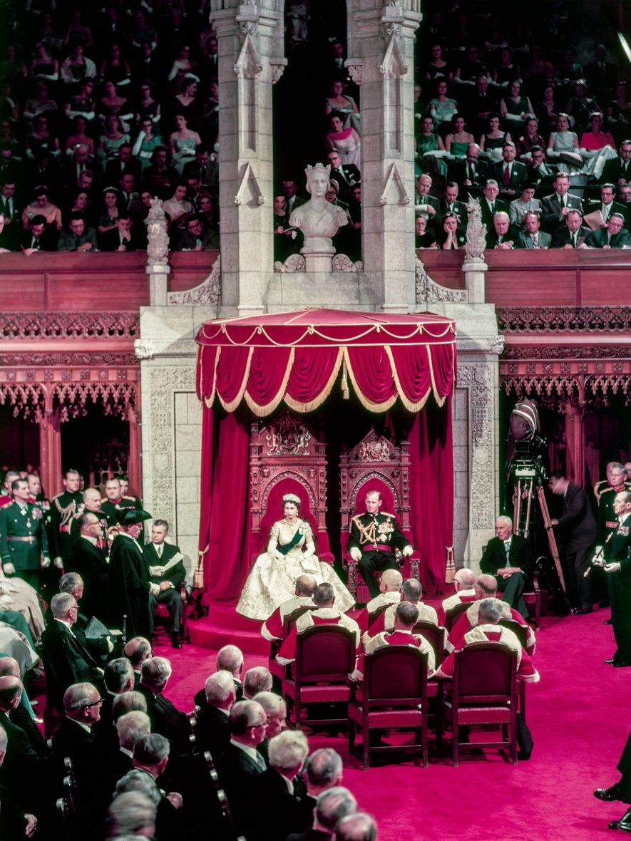 Queen Elizabeth II opens a session of the Parliament of Canada in Ontario with Prince Philip ...