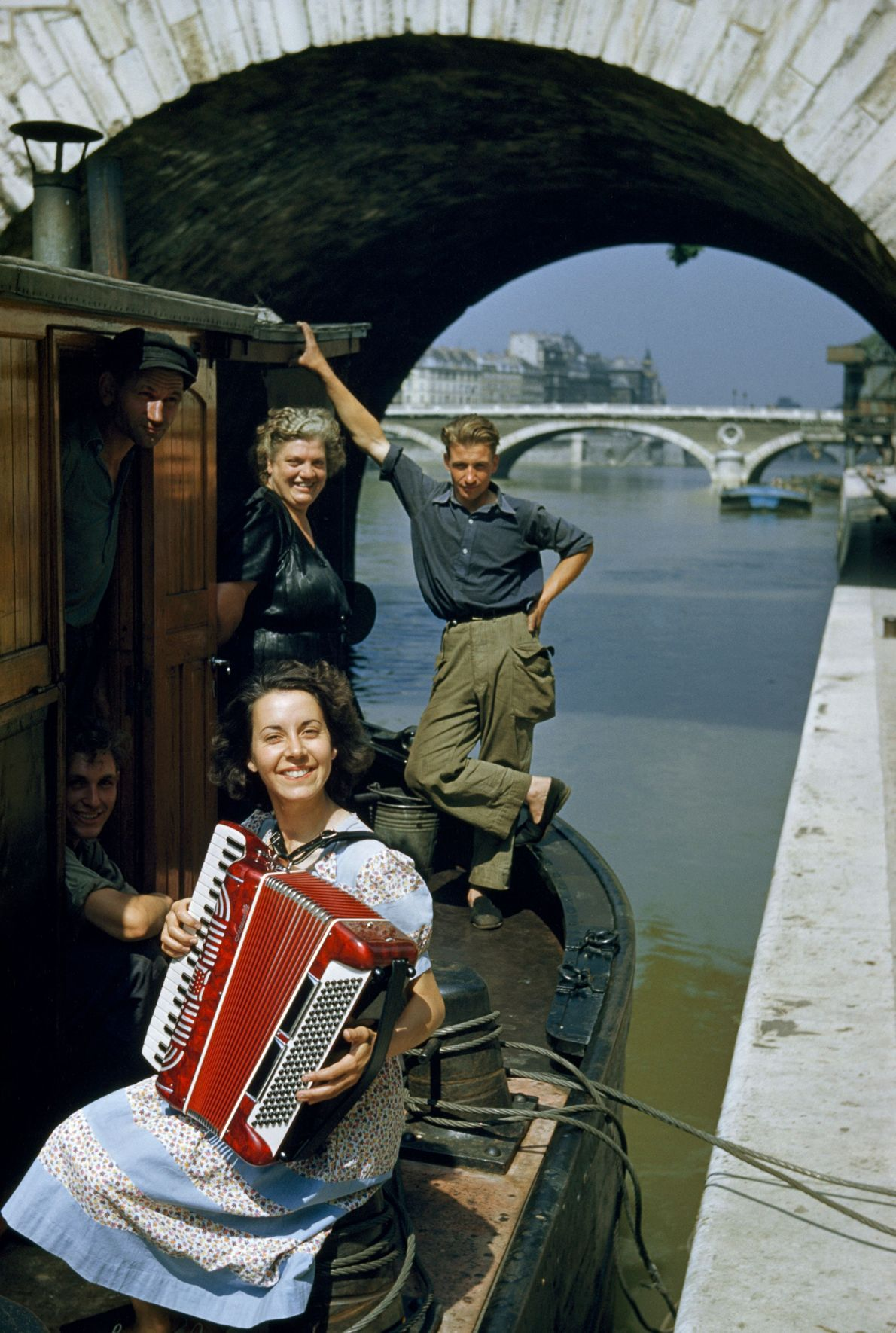 Accordion tunes set the mood on a Seine River cruise.
