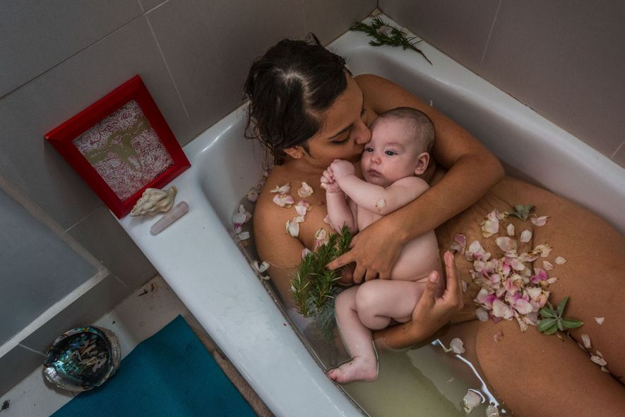 A mother and her baby celebrate the end of her cuarentena, or quarentine, with an herbal ...