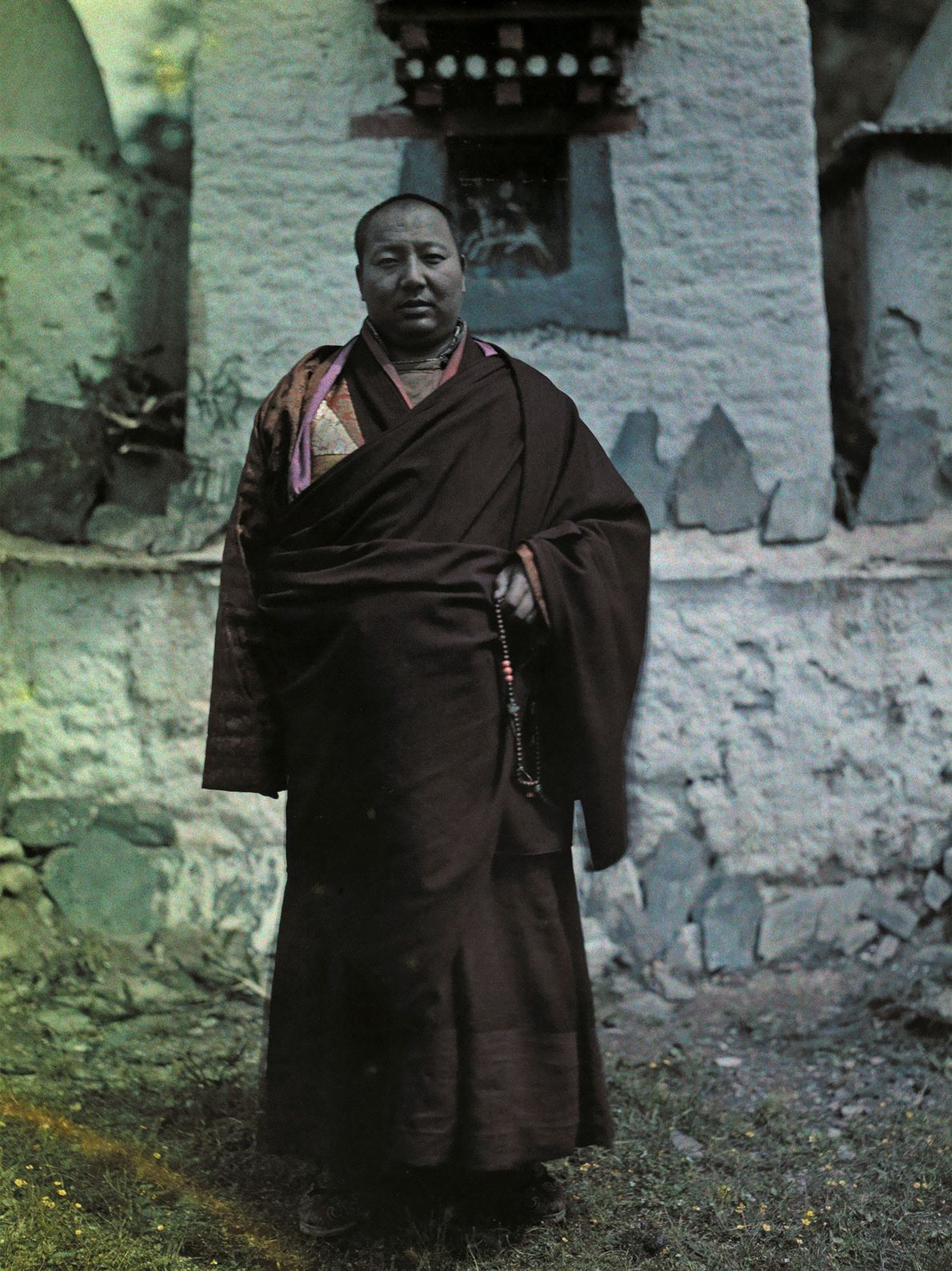 Hang Kai Huei, ruler of the Gelugpa Buddhist kingdom of Muli, stands in front of a ...