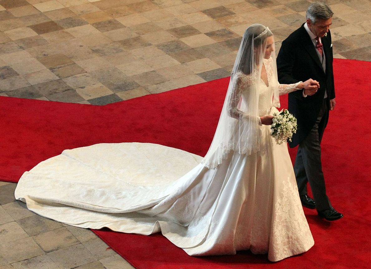 Like her new mother-in-law's 1947 wedding dress, Kate Middleton's dress blooms with flora, including embroidered roses, ...