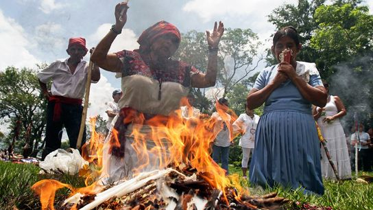 Modern-day Maya pray in anticipation of the summer solstice at the ancient Maya site of Tazumal. ...