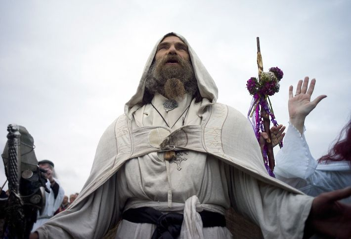 A Druid at the United Kingdom's ancient Stonehenge monument prayerfully greets the Northern Hemisphere's summer solstice. ...