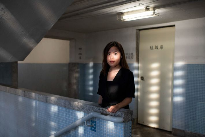 Sandy Au, 28, stands inside one of the circular buildings at Lai Tak Tsuen, a public ...