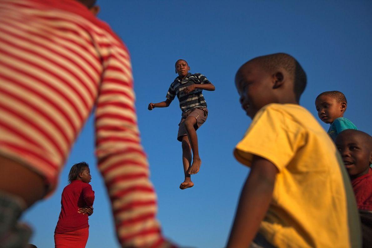 boy jump trampoline