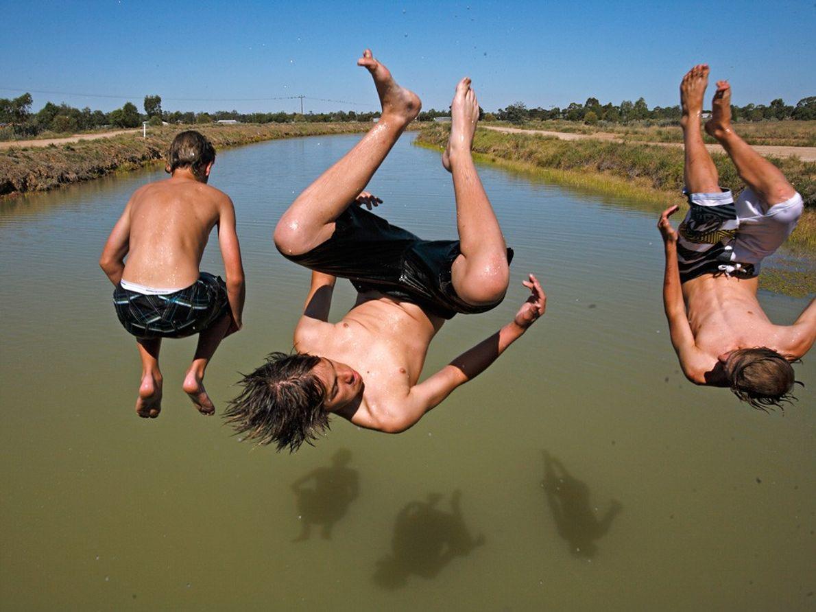 Three Boys in Midair