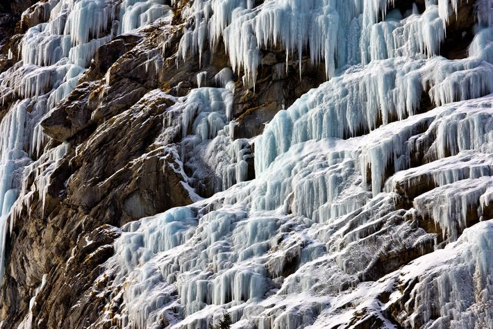Switzerland's many waterfalls — including this one near the village of Vals — freeze over in winter, creating ...