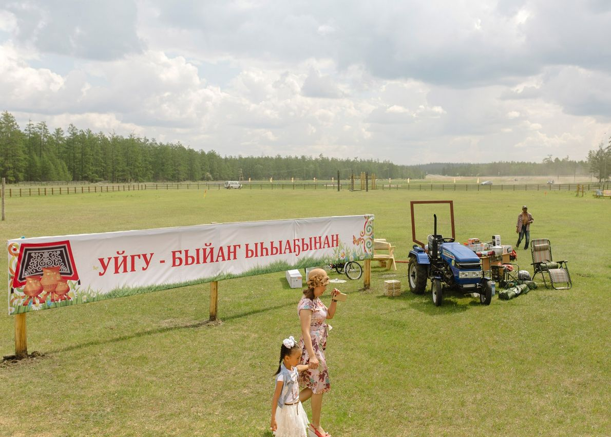 Lottery prizes are called out at the end of the Ysyakh festival in the village of ...
