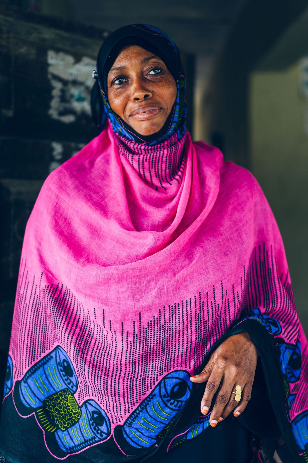 An off duty nurse stands for a portrait before heading home, Pemba