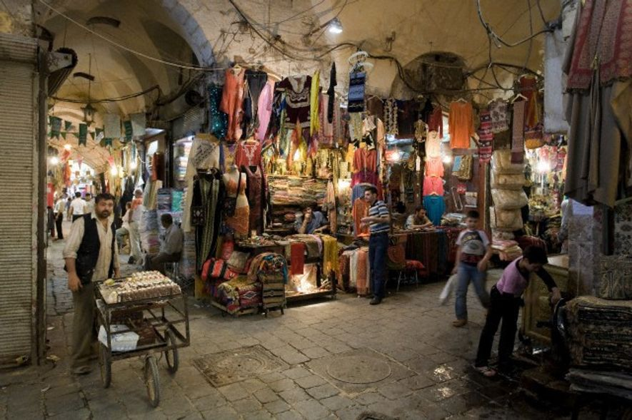 Tunnel vision: Rich shopping in the Damascus souk.