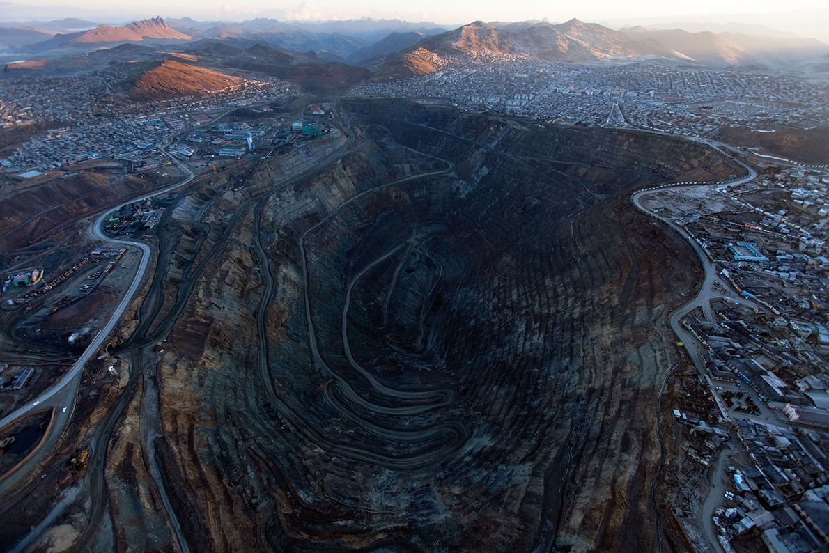The historic center of Cerro de Pasco, Peru, has been largely consumed by a quarter-mile-deep mine, ...