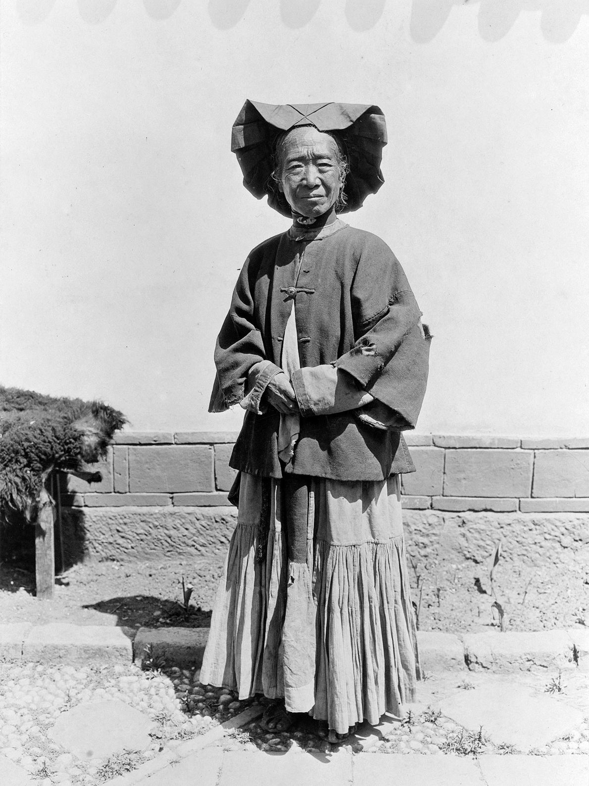 This portrait of an elderly Yi woman in Yunnan Province, China, shows off her hat, which ...
