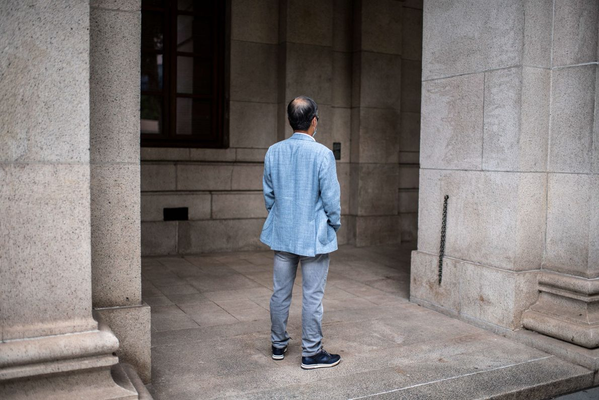 A pro-Beijing doctor in his 60s stands in front of the Hong Kong Court of Final ...