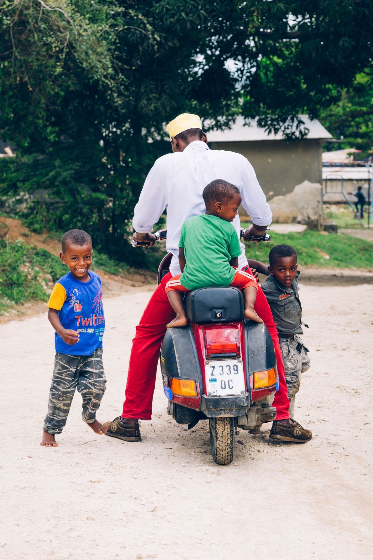A father and his three boys saddle up before heading out for a ride, Pemba