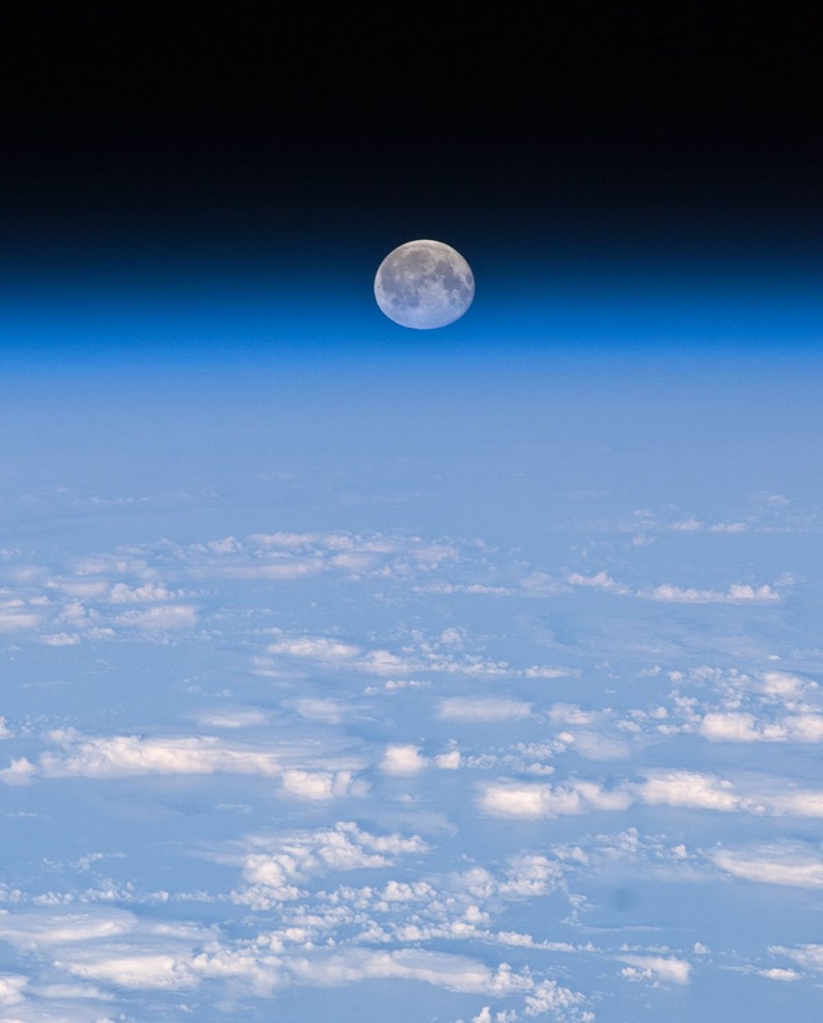 The full moon appears to sink into Earth's atmosphere in a November 2013 photograph from the ...