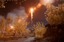 In this false-color infrared image, the Soyuz MS-10 spacecraft is seen launching from the Baikonur Cosmodrome ...