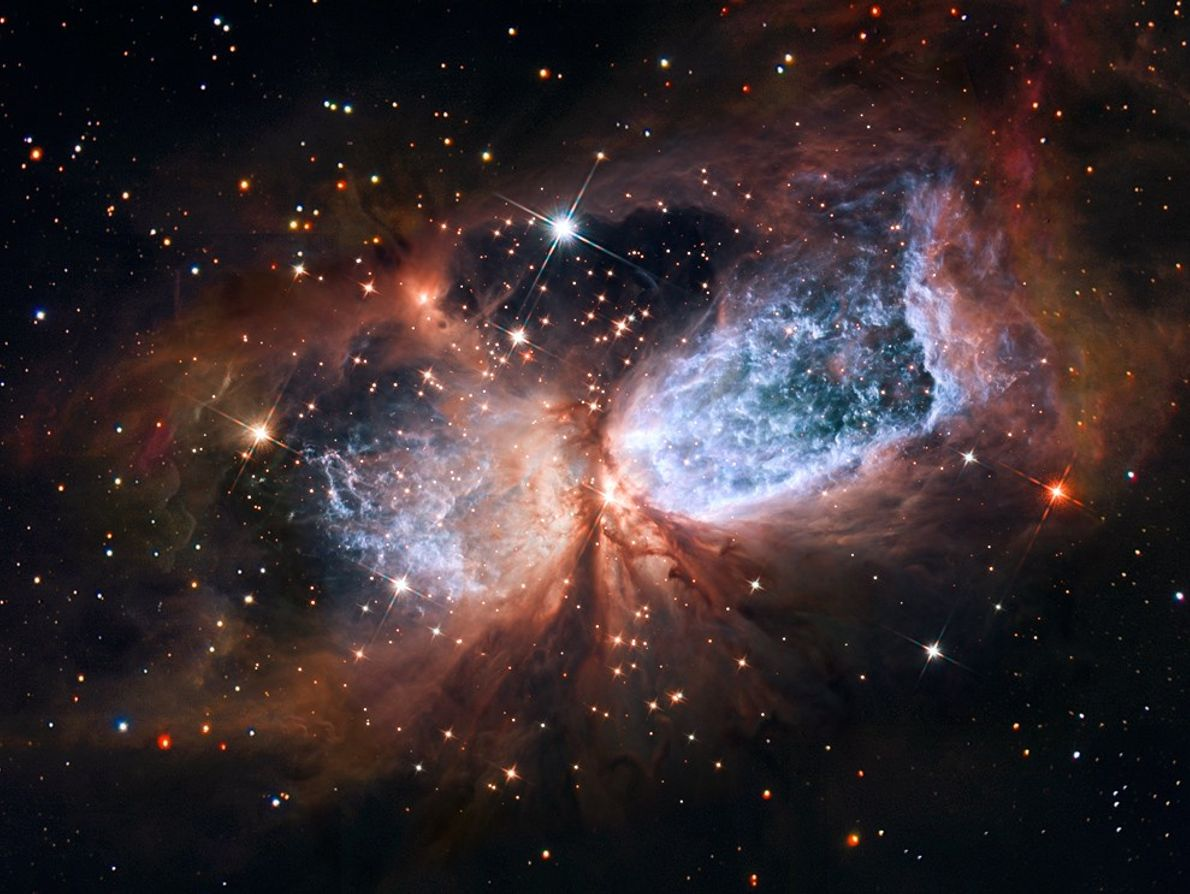A cosmic angel seems to spread its shimmering wings in a newly released Hubble Space Telescope ...