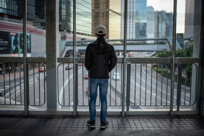 A 19-year-old student protester stands on a pedestrian walkway overlooking Harcourt Road, the site of the ...