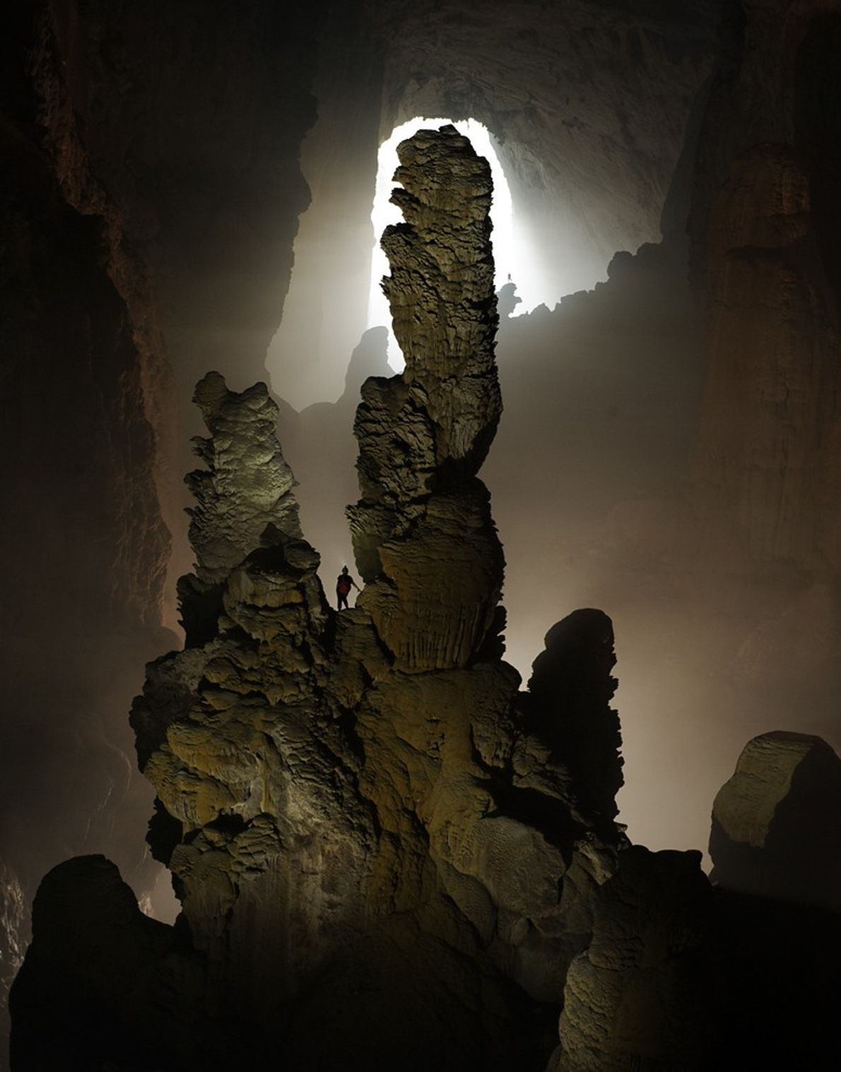 A spelunker takes a close look at the Hand of Dog stalagmite in Hang Son Doong ...