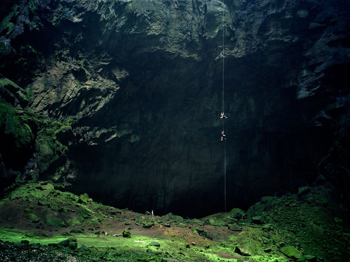 Like spiders on silk, cavers begin an eye-popping descent into the Cave of Swallows, a Mexican ...
