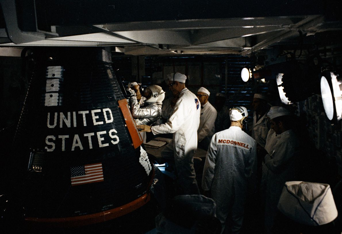 Gordon Cooper is inserted into the capsule of the final Mercury flight, MA-9  – launched on May 15, ...