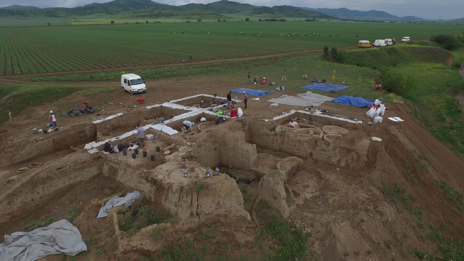 Archaeologists excavating this Neolithic village in Georgia found pieces of clay pots containing residues of the ...