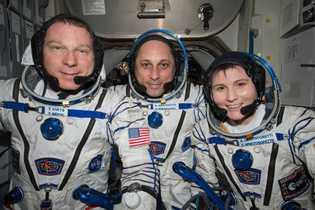 Terry Virts (left) with cosmonaut Anton Shkaplerov (centre) and ESA astronaut Samantha Cristoforetti.