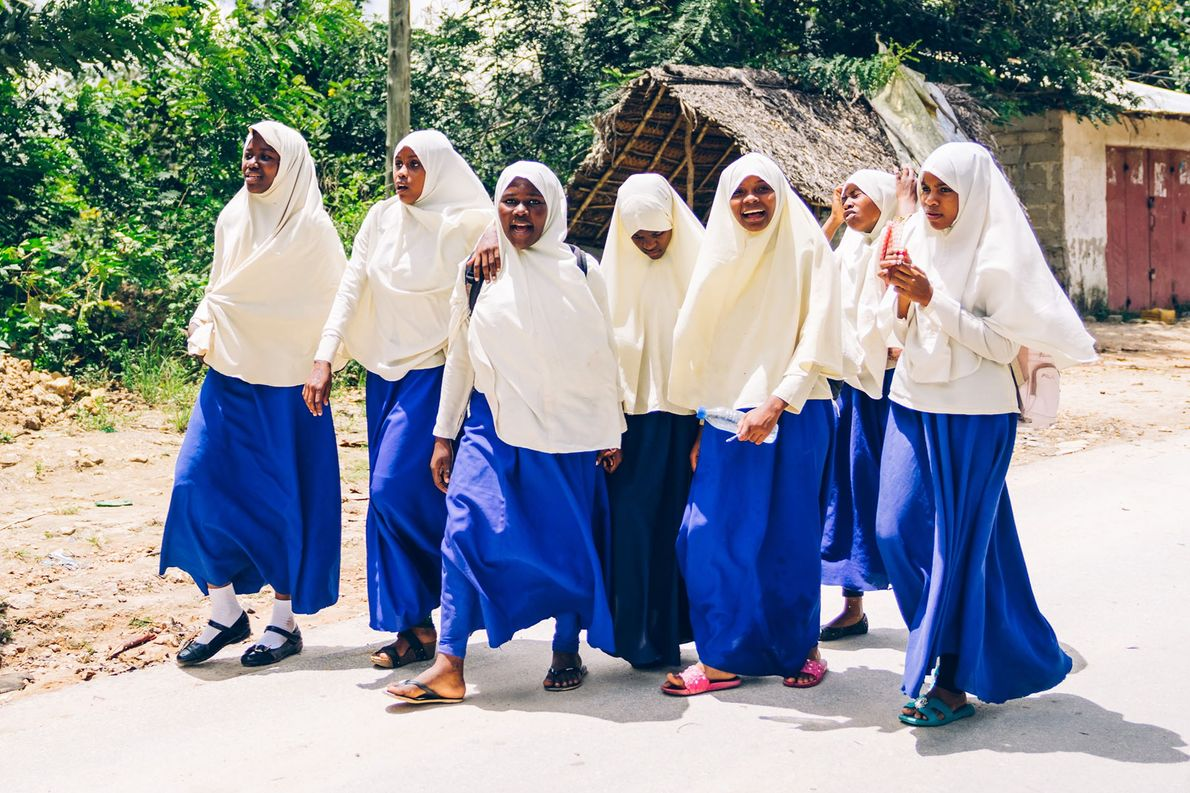 School's out and the girls are heading home, Pemba