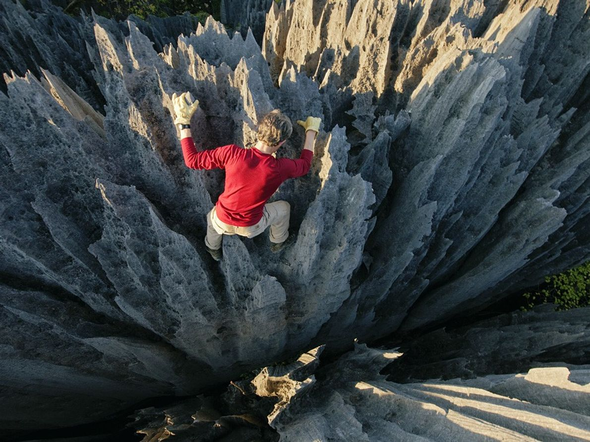 """Climber John """"Razor Sharp"""" Benson weaves through skin-ripping pinnacles. In Malagasy, the formations are called tsingy, ..."""