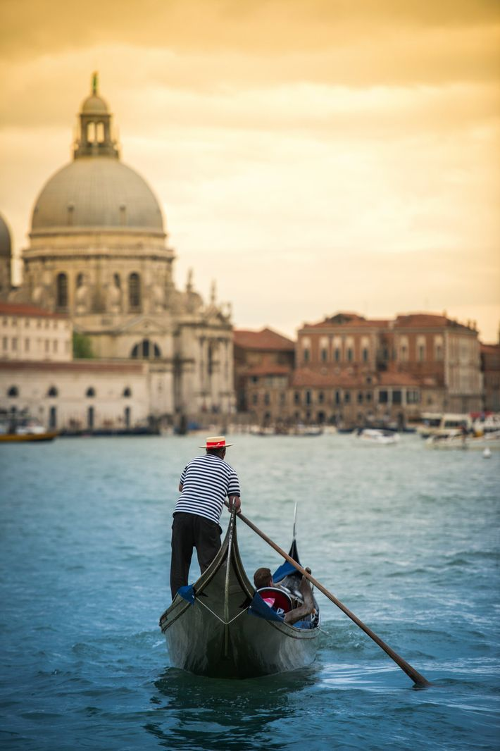 A gondola makes its way down the Grand Canal in Venice.