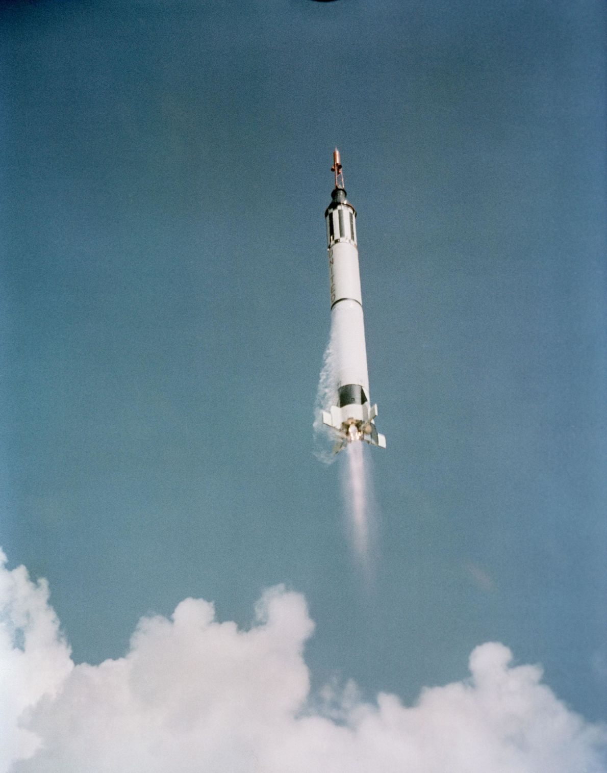 Alan Shepard blasts off in the Freedom 7 capsule atop the Mercury-Redstone 3: May 5th, 1961. ...