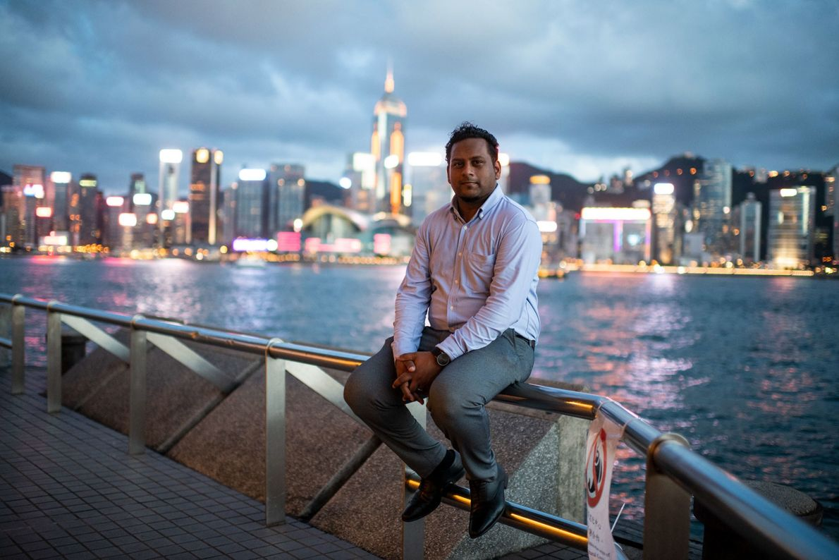 Social worker Jeffrey Andrews, 35, sits at the Tsim Sha Tsui harborfront with the Hong Kong ...