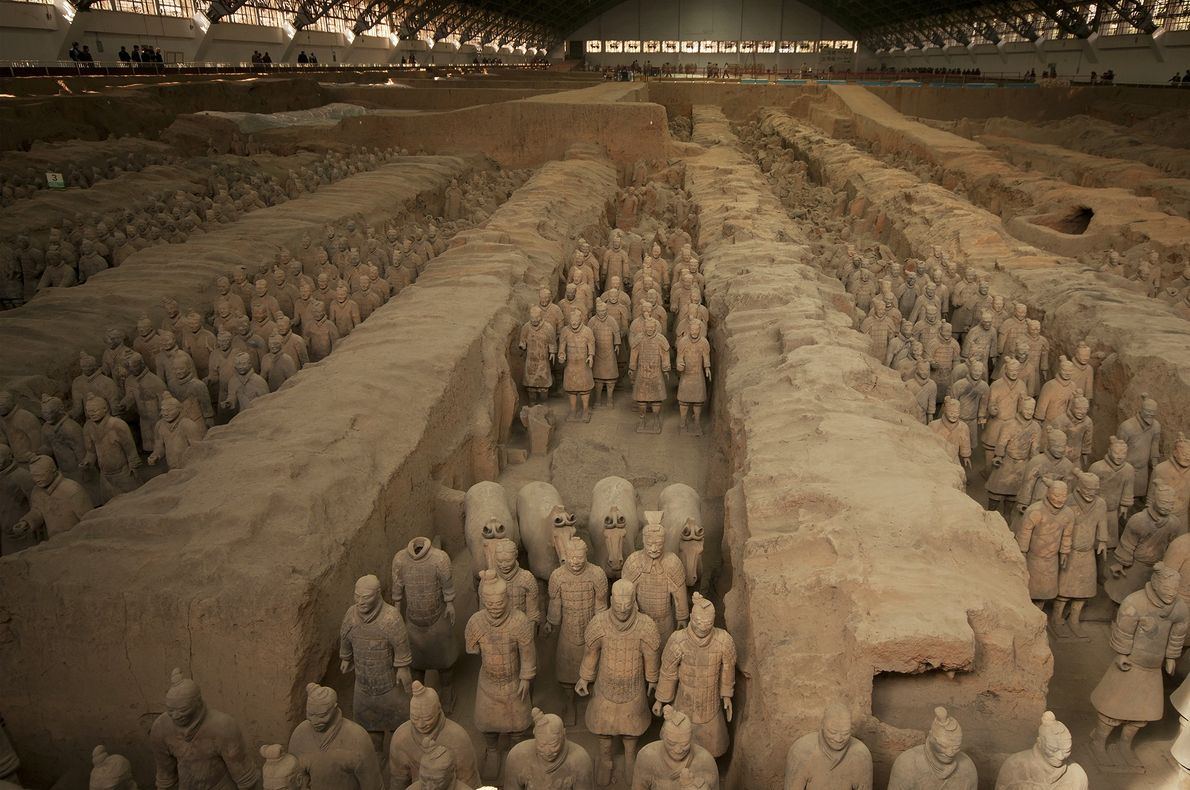 Thousands of life-size clay soldiers and horses stand guard over Emperor Qin Shi Huang's tomb near …