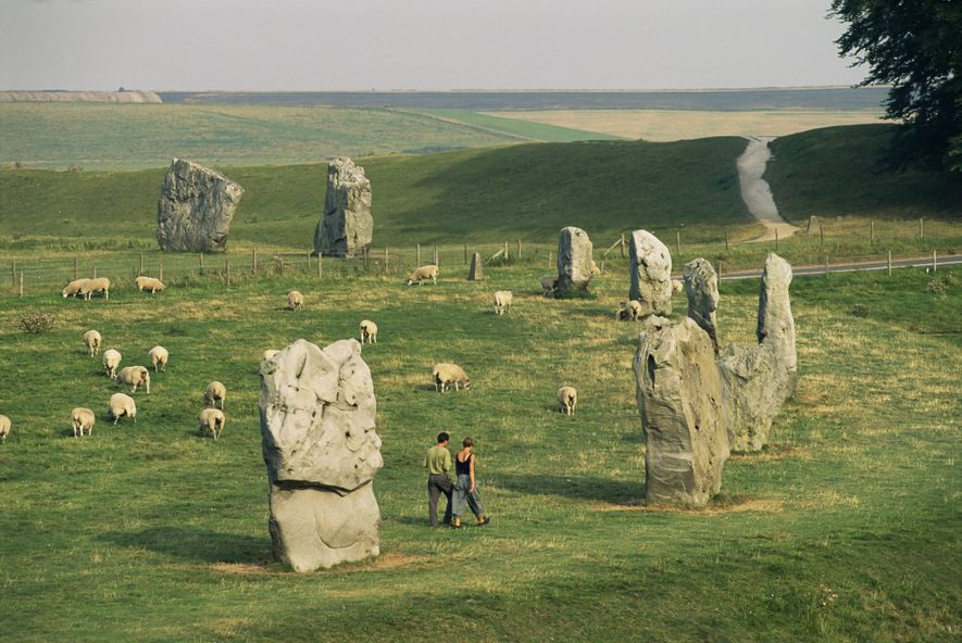 Sheep graze on the meadows around Avebury, one of the most famous Neolithic monuments in Britain.