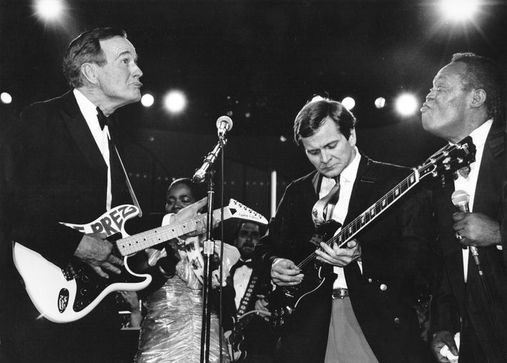 Newly elected President George H.W. Bush (left) jams onstage with Republican Committee Chairman Lee Atwater (center), ...