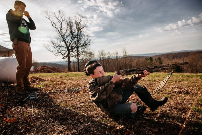 """""""This photograph shows a young child practicing for youth spring turkey season which opened the following ..."""