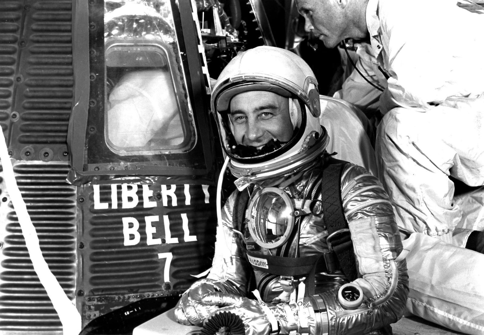 1961: Virgil 'Gus' Grissom poses outside the Liberty Bell 7 capsule – complete with white-painted 'crack'. ...