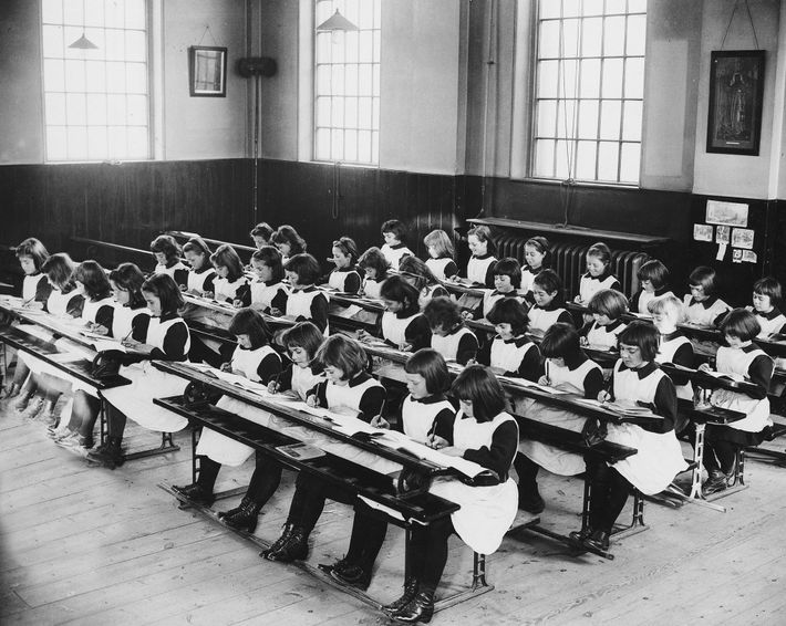 Rows of girls concentrate on their studies at the Foundling Hospital.