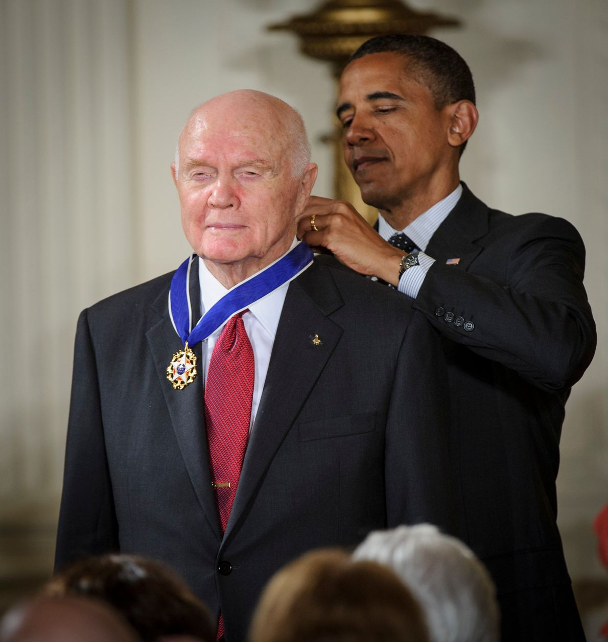 John Glenn is presented with the Presidential Medal of Freedom by Barack Obama, 2012. The son ...