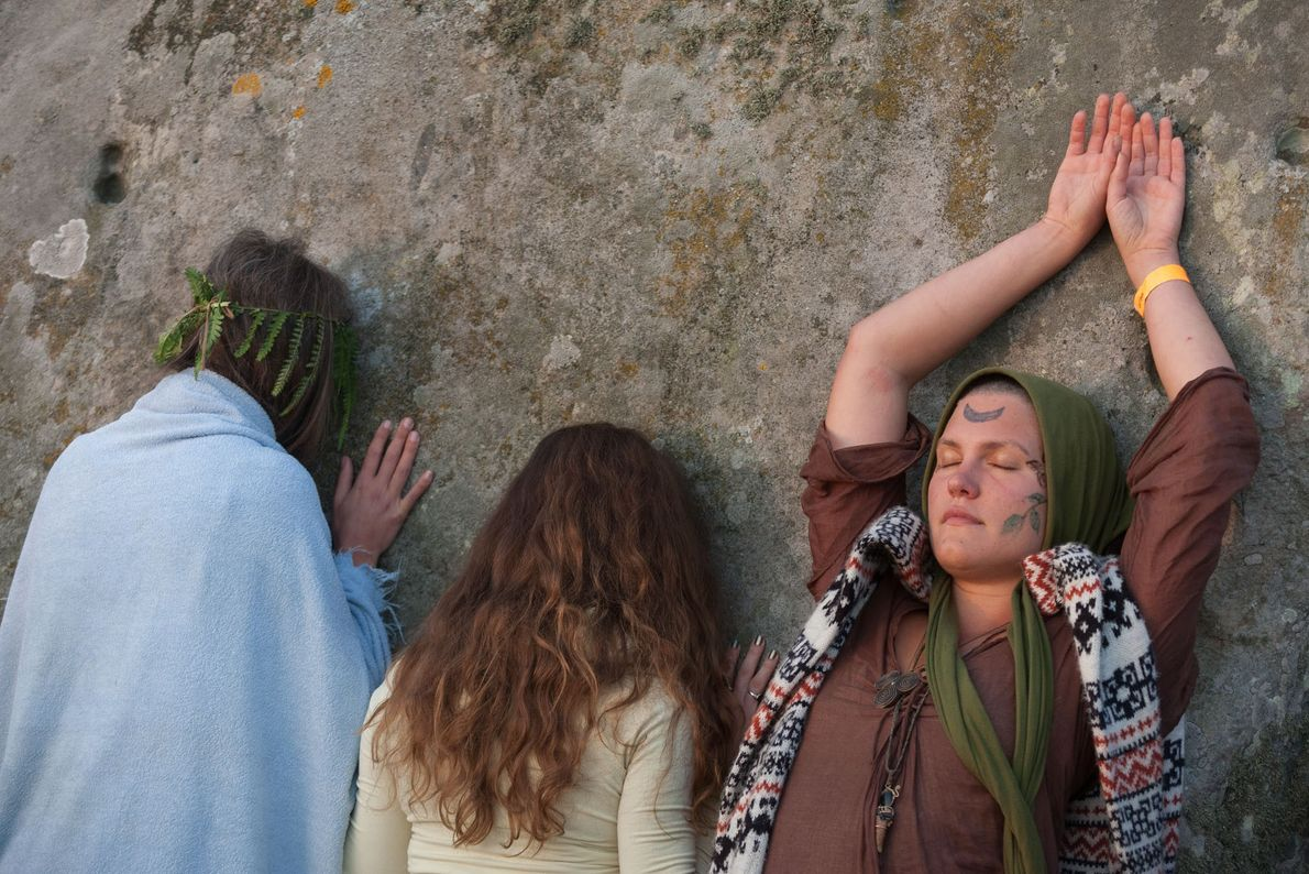 Spiritual revellers celebrate the summer Solstice (mid-summer and longest day) at the ancient stones of Stonehenge ...